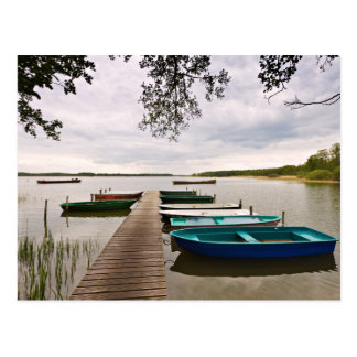 Moorings with boats on a lake postcard