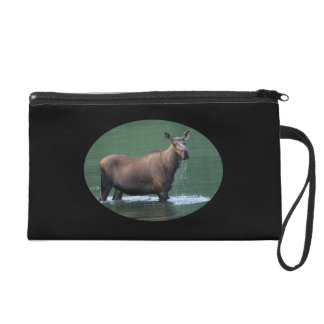 Moose in pool of emerald water wristlet clutches