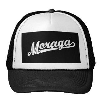 Moraga script logo in white distressed trucker hat