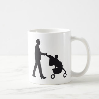 more father woman with baby in barrow coffee mug