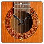 Moreno anaranjado de la guitarra clásica reloj