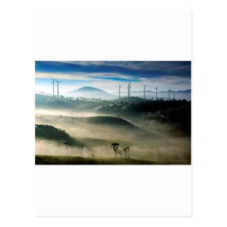 Morning fog in wind farm scenic landscape postcard