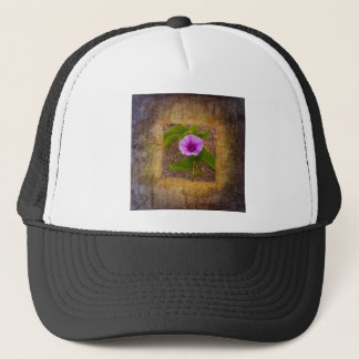 Morning glory flower on a textured background trucker hat