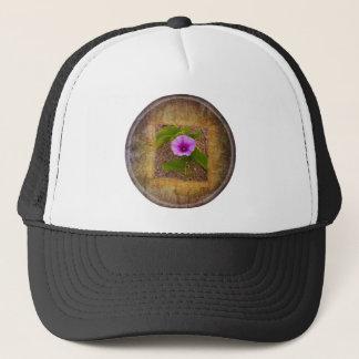 Morning glory flower on textured background trucker hat