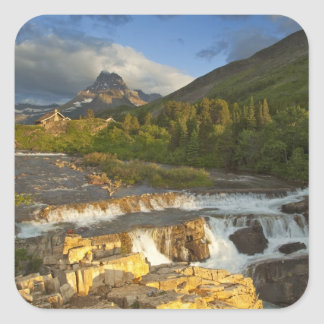 Morning light greets Swiftcurrent Falls in the Square Sticker