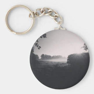 Morning mist and low sun on the field when droppib keychain
