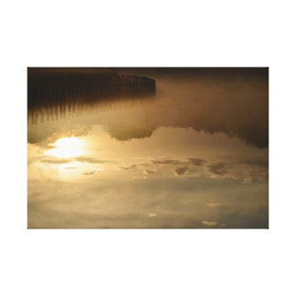 Morning sky and sun water reflection canvas print