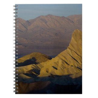 Mornings first light on  Zabriskie Point and 3 Notebook