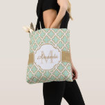 "Moroccan Quatrefoil Pattern Gold Mint Monogram Tote Bag<br><div class=""desc"">This personalized &quot;Moroccan Quatrefoil Pattern Gold Mint Monogram&quot; Tote Bag is a great every day bag to take you through your day! Carry a custom tote bag and head out to the street,  supermarket,  school,  or park. It&#39;s a perfect way to show off your own style.</div>"