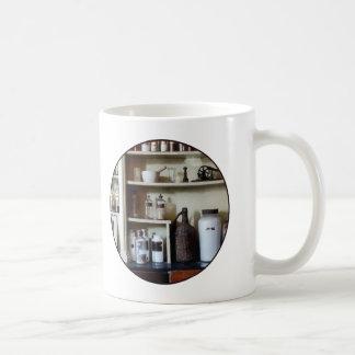 Mortar and Pestle and Bottles on Shelves Coffee Mug