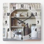 Mortar and Pestle and Bottles on Shelves Square Wall Clocks
