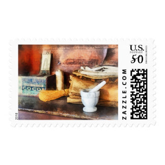 Mortar and Pestle and Box of Cocoa Postage