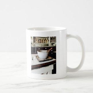 Mortero y maja en boticario taza de café