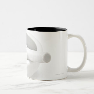 Mortero y maja taza de café de dos colores