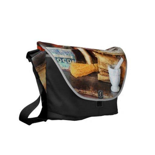 Mortero y maja y caja de cacao bolsa messenger