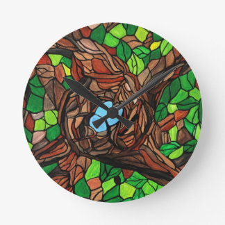 mosaic painting of birds eggs in a tree round clock