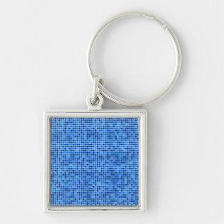 Mosaico azul del pixel llavero cuadrado plateado