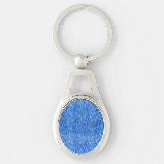 Mosaico azul del pixel llavero plateado ovalado