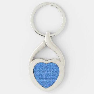 Mosaico azul del pixel llavero plateado en forma de corazón