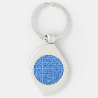 Mosaico azul del pixel llavero plateado en forma de espiral