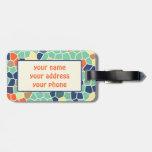 Mosaico enrrollado abstracto anaranjado colorido d etiquetas maletas
