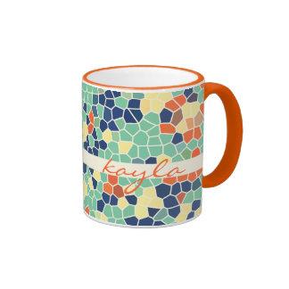 Mosaico enrrollado abstracto anaranjado colorido d taza de café