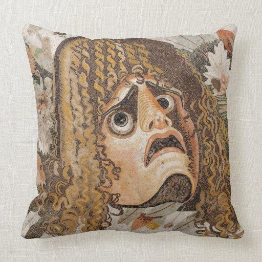 Mosaico romano, con la máscara, las hojas y la fru almohada
