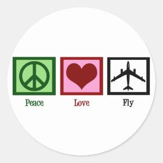Mosca del amor de la paz pegatina redonda