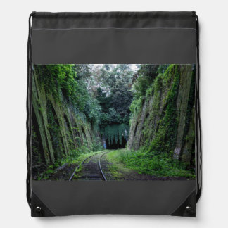 Moss and vines covering an abandoned rail track drawstring bag