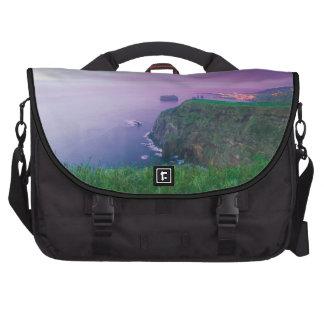 Mosteiros coastal sunset laptop bags