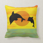 Mother and baby dolphin leaping out of the sea throw pillows