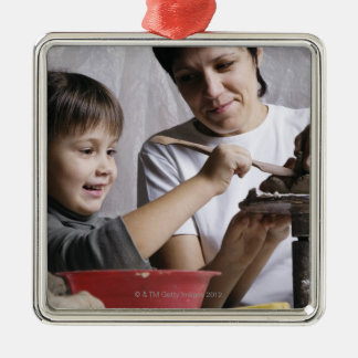 mother and daughter forming sculpture out of metal ornament