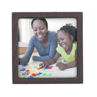 Mother and daughter playing with letters jewelry box