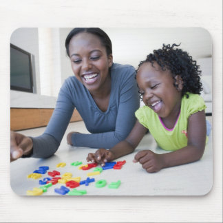 Mother and daughter playing with letters mouse pad