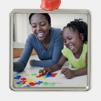 Mother and daughter playing with letters square metal christmas ornament