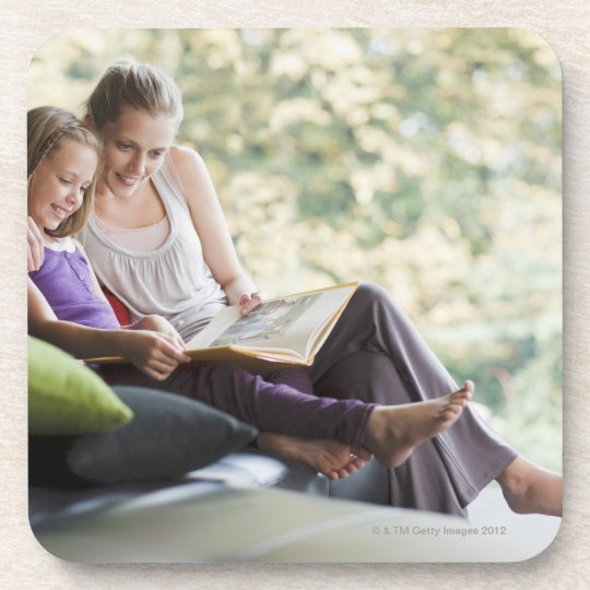 Mother and daughter reading storybook beverage coaster