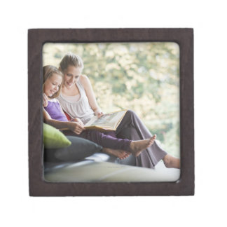 Mother and daughter reading storybook gift box