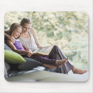 Mother and daughter reading storybook mouse pads