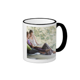 Mother and daughter reading storybook coffee mug
