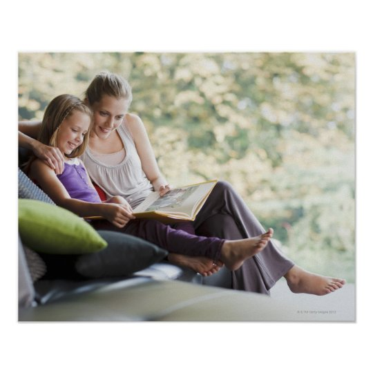 Mother and daughter reading storybook poster