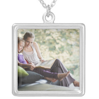 Mother and daughter reading storybook silver plated necklace