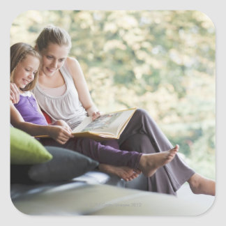 Mother and daughter reading storybook square sticker