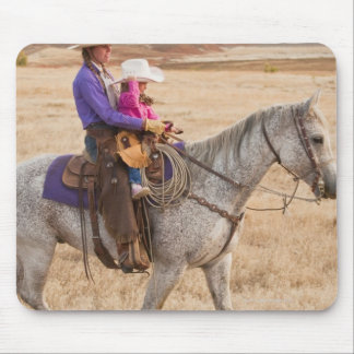 Mother and daughter riding horse mouse pads