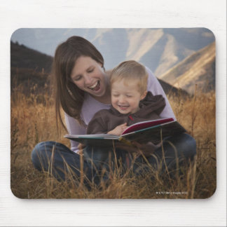 Mother and son reading outdoors mouse pad