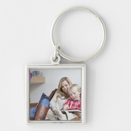Mother and son sitting on sofa together keychain