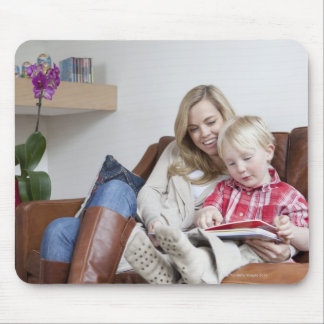 Mother and son sitting on sofa together mouse pad