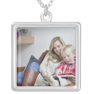 Mother and son sitting on sofa together silver plated necklace