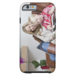 Mother and son sitting on sofa together tough iPhone 6 case