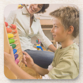 Mother and son using abacus beverage coaster