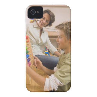Mother and son using abacus Case-Mate iPhone 4 cases
